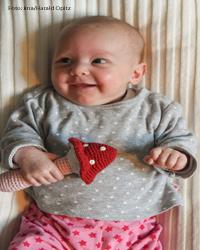 Ein Kind lacht. Foto: kna/Harald Oppitz